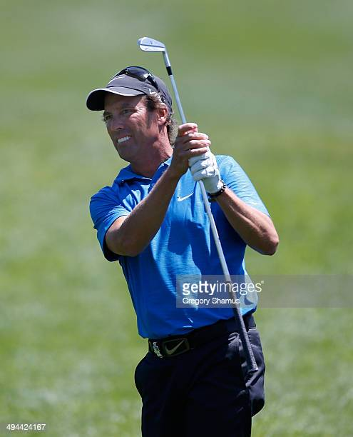 Stephen Ames watches hits his second shot on the first hole during the final round of the 2014 Senior PGA Championship presented by KitchenAid at the...