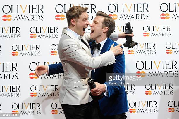Stephen Ashfield with his Best Supporting Role in a Musical award for The Book of Mormon and Gavin Creel with his Best Actor in a Musical award for...