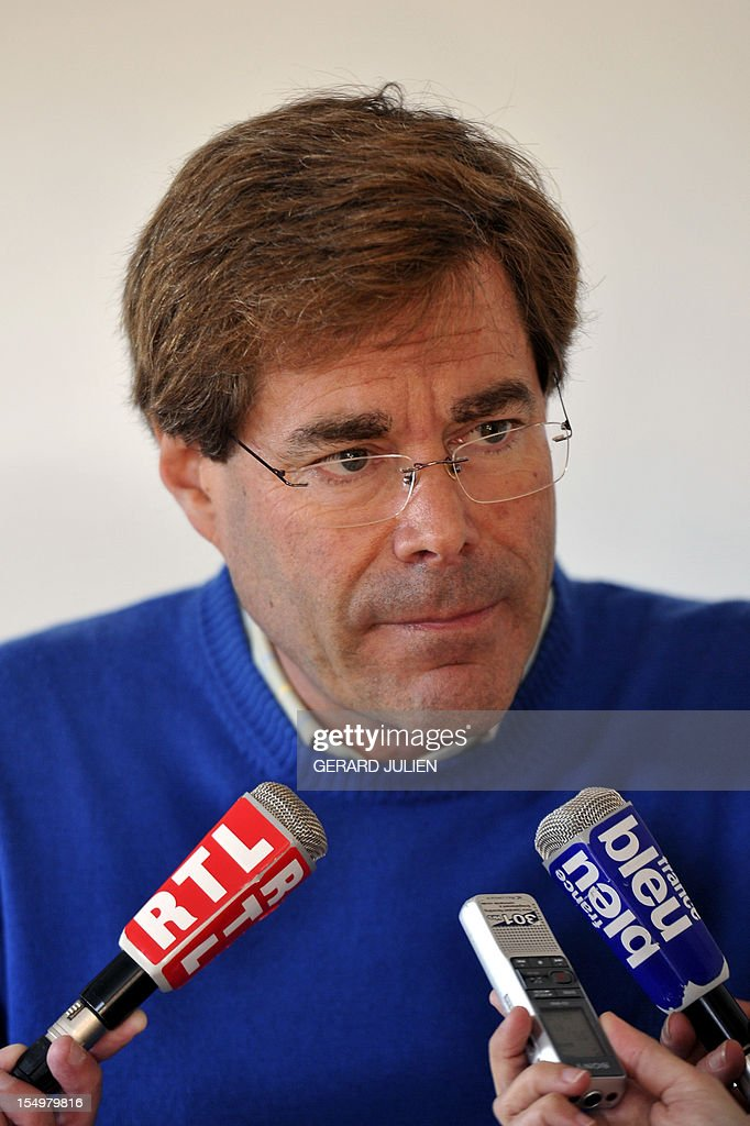 Stephen Barnes, the father of a 12-year-old British boy, who disappeared on October 27 on the Porquerolles island answers to journalists' questions on October 29, 2012 as part of the search for his boy. Sixty soldiers and three civil security dog-handlers from Brignoles are paricipating in the search.