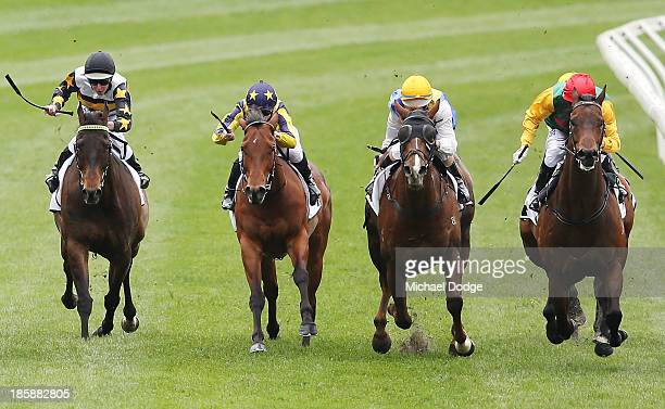 Stephen Baster riding Canali wins race 2 the 1Printcomau Handicap during Cox Plate Day at Moonee Valley Racecourse on October 26 2013 in Melbourne...