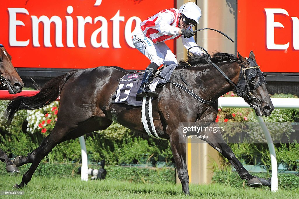 Stephen Baster riding Ferlax wins the Australian Guineas during Melbourne Racing at Flemington Racecourse on March 2, 2013 in Melbourne, Australia.