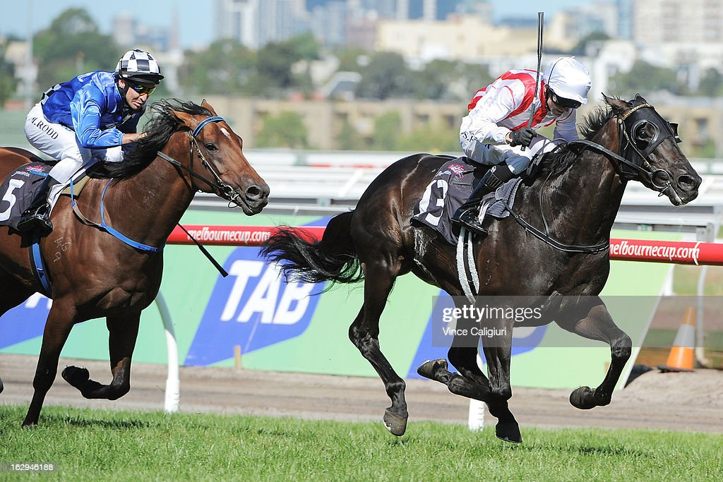 Stephen Baster riding Ferlax wins the Australian Guineas from <a gi-track='captionPersonalityLinkClicked' href=/galleries/search?phrase=Michael+Rodd&family=editorial&specificpeople=850617 ng-click='$event.stopPropagation()'>Michael Rodd</a> riding Sheer Talent during Melbourne Racing at Flemington Racecourse on March 2, 2013 in Melbourne, Australia.