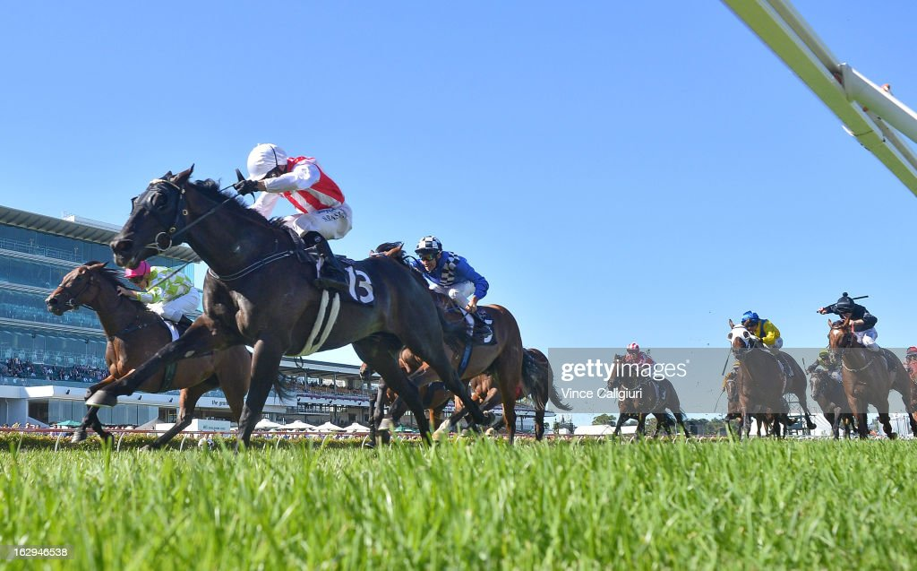 Stephen Baster riding Ferlax (13) wins the Australian Guineas from Vlad Duric riding You're So Good and <a gi-track='captionPersonalityLinkClicked' href=/galleries/search?phrase=Michael+Rodd&family=editorial&specificpeople=850617 ng-click='$event.stopPropagation()'>Michael Rodd</a> riding Sheer Talent during Melbourne Racing at Flemington Racecourse on March 2, 2013 in Melbourne, Australia.