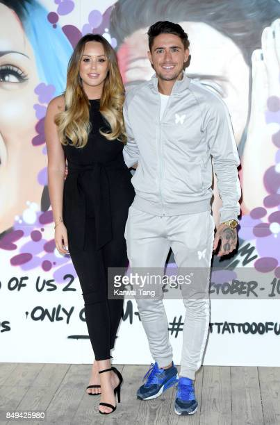 Stephen Bear and Charlotte Crosby attend a photocall for 'Just Tattoo Of Us Can You Deal With The Reveal' popup tattoo parlour on September 19 2017...