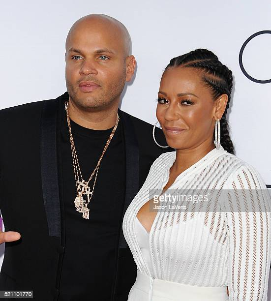 Stephen Belafonte and Melanie 'Mel B' Brown attend the premiere of 'Mother's Day' at TCL Chinese Theatre IMAX on April 13 2016 in Hollywood California
