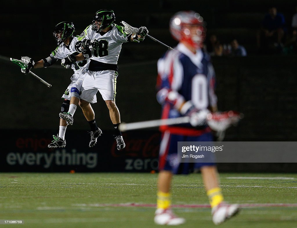 Stephen Berger #13 and Stephen Peyser #18 of the New York Lizards celebrate a goal as Will Manny #0 of the Boston Cannons walks off the field in the second half at Harvard Stadium on June 21, 2013 in Boston, Massachusetts.