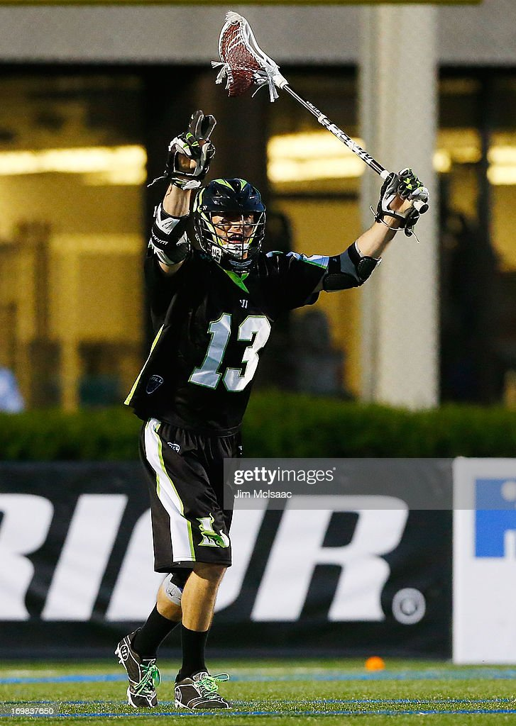 Stephen Berger #13 of the New York Lizards celebrates against the Charlotte Hounds during their Major League Lacrosse game at Shuart Stadium on May 31, 2013 in Uniondale, New York. The Hounds defeated the Lizards 14-12.