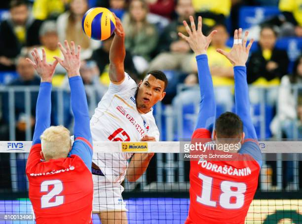 Stephen Boyer of France spikes the ball against Serbia during the match between Serbia and France at Arena da Baixada Stadium during day three of the...