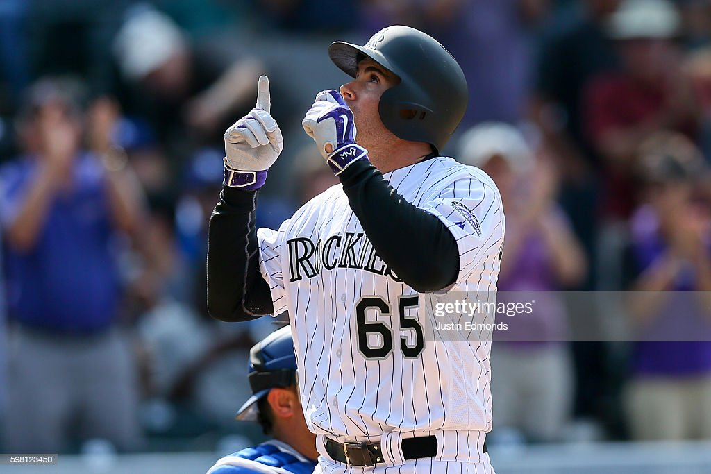 Stephen Cardullo #65 of the Colorado Rockies celebrates his first career Major League home run during the seventh inning against the Los Angeles Dodgers at Coors Field on August 31, 2016 in Denver, Colorado.