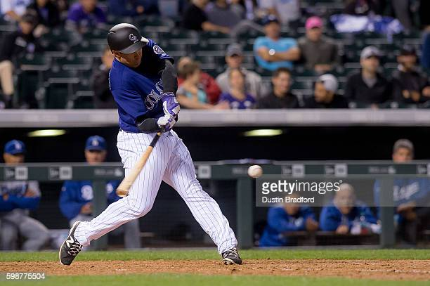 Stephen Cardullo of the Colorado Rockies hits a single for his first major league hit off of JP Howell of the Los Angeles Dodgers in the eighth...