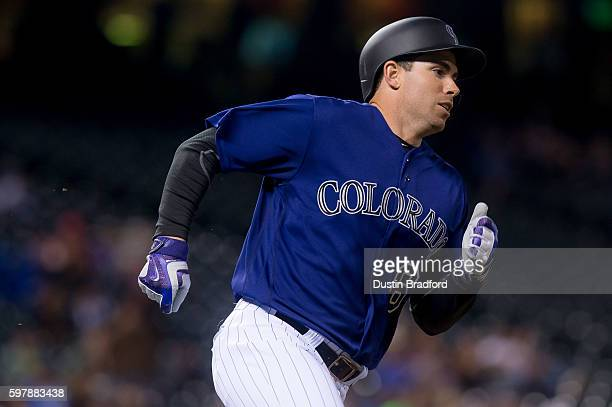 Stephen Cardullo of the Colorado Rockies runs out a single for his first major league hit off of JP Howell of the Los Angeles Dodgers in the eighth...