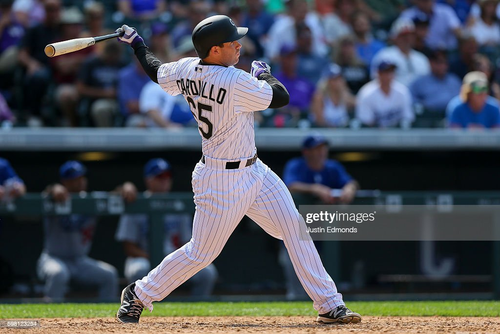 Stephen Cardullo #65 of the Colorado Rockies watches his first career Major League home run during the seventh inning against the Los Angeles Dodgers at Coors Field on August 31, 2016 in Denver, Colorado.