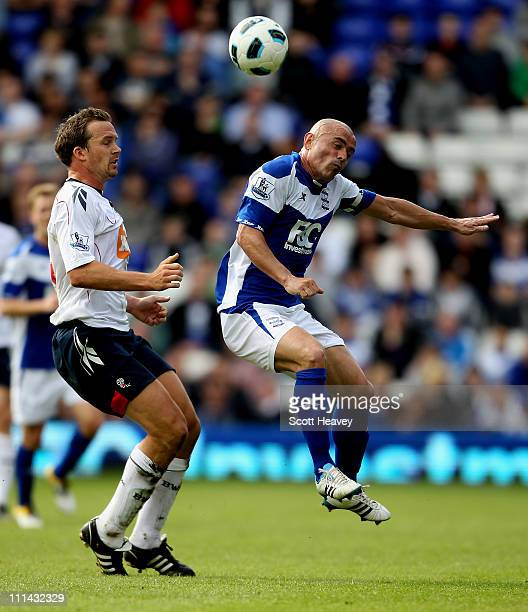 Stephen Carr of Birmingham in action with Kevin Davies of Bolton during the Barclays Premier League match between Birmingham City and Bolton...