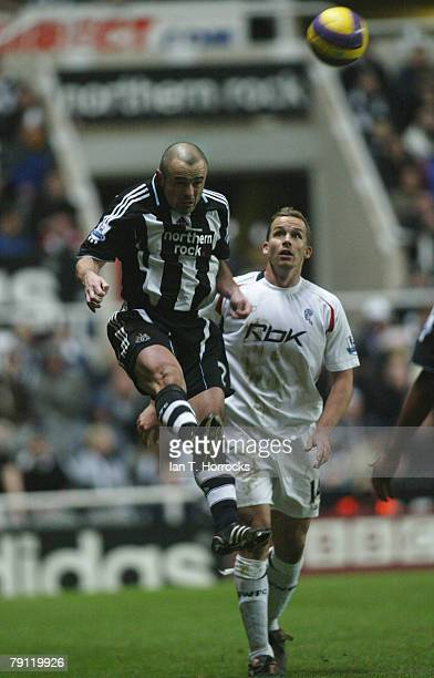 Stephen Carr of Newcastle jumps ahead of Kevin Davies during the Barclays Premier match between Newcastle United and Bolton at St James' Park on...