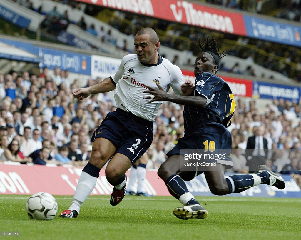 Stephen Carr of Tottenham Hotspur is challenged by Lamine Sakho of Leeds United during the FA Barclaycard Premiership match held on August 23, 2003, at White Hart Lane, in London. Tottenham Hotspur won the match 2-1.