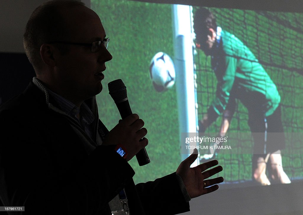 Stephen Carter of Hawk-Eye Innovations explains the company's goal-line technology at Toyota Stadium in Toyota, Aichi prefecture on December 8, 2012 which is being used in the 2012 Club World Cup tournament in Japan. Hawkeye, which is familiar from tennis and cricket and uses cameras to track a ball's position and trajectory, will be tested at the competitions in Toyota. The ninth edition of the FIFA Club World Cup football tournament is taking place from December 6 to 16.
