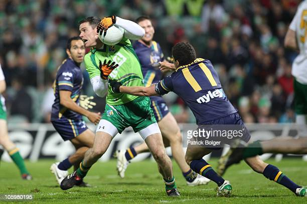 Stephen Cluxton of Ireland and Leigh Montagna of Australia in action during the International Rules series First Test between Ireland and Australia...