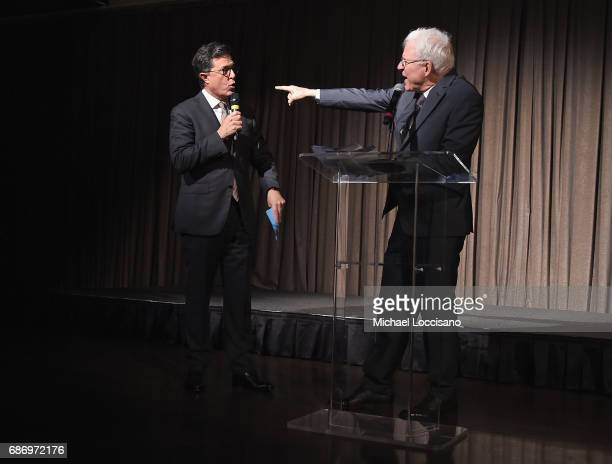 Stephen Colbert and Steve Martin perform a bit during the Elevator Repair Service Theater 25th Anniversary Gala at Tribeca Rooftop on May 22 2017 in...