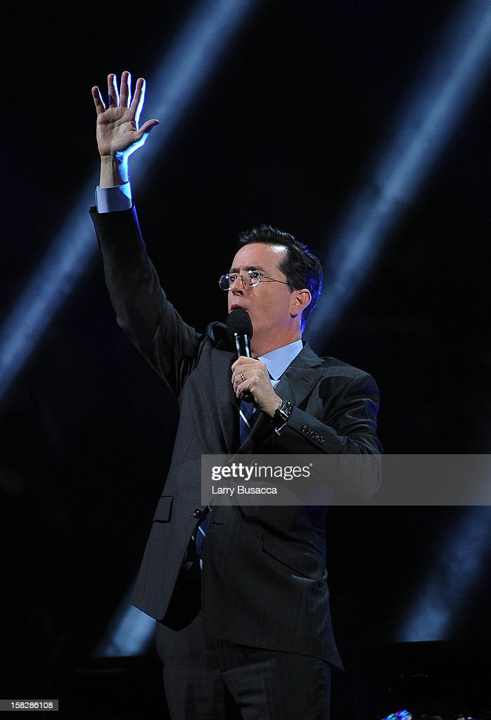 Stephen Colbert performs at '12-12-12' a concert benefiting The Robin Hood Relief Fund to aid the victims of Hurricane Sandy presented by Clear Channel Media & Entertainment, The Madison Square Garden Company and The Weinstein Company at Madison Square Garden on December 12, 2012 in New York City.