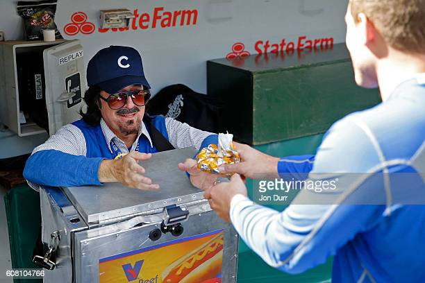 Stephen Colbert playing the role of Wrigley Field hot dog vendor Donny Franks shares a laugh with Anthony Rizzo of the Chicago Cubs while sitting in...