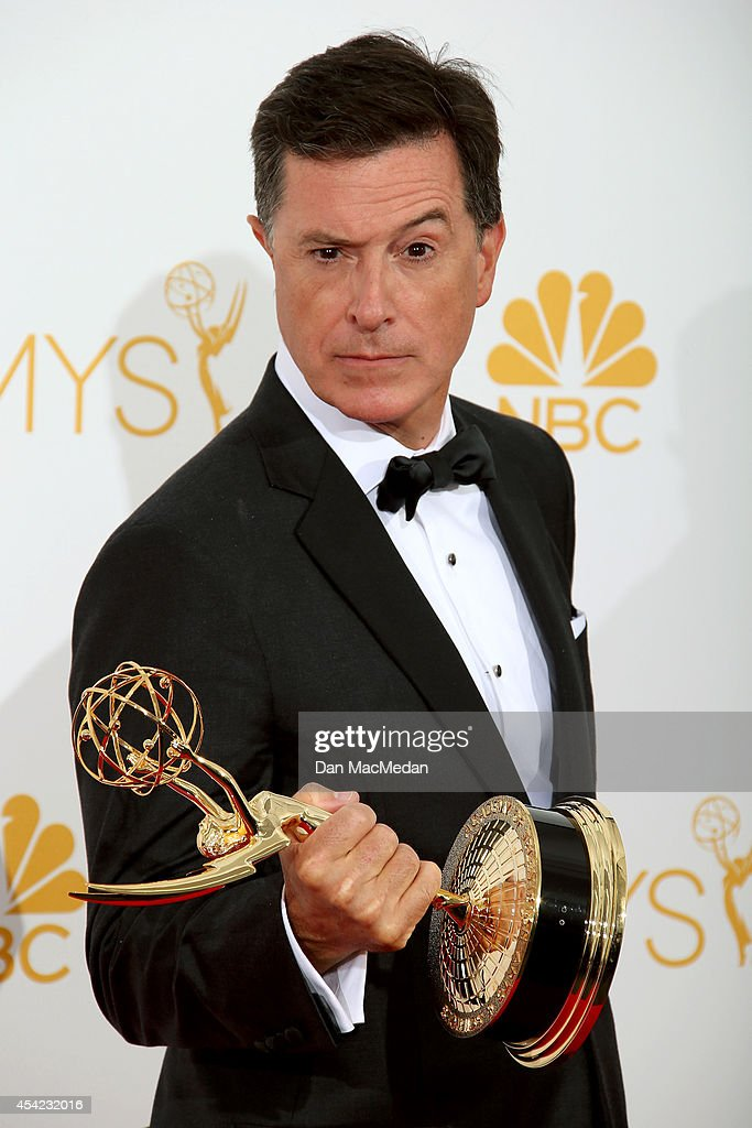 <a gi-track='captionPersonalityLinkClicked' href=/galleries/search?phrase=Stephen+Colbert&family=editorial&specificpeople=215133 ng-click='$event.stopPropagation()'>Stephen Colbert</a> poses in the photo room with his award for Outstanding Variety, Music Or Comedy Series for 'The Colbert Report' at Nokia Theatre L.A. Live on August 25, 2014 in Los Angeles, California.