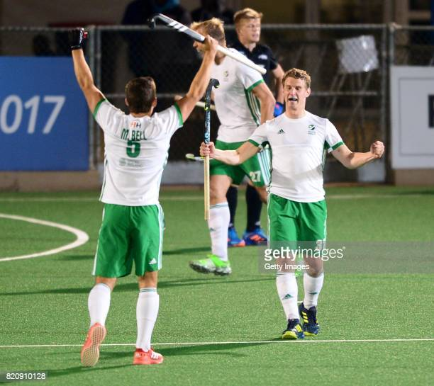 Stephen Cole and Matthew Bell of Ireland celebrate celebrate during day 8 of the FIH Hockey World League Men's Semi Finals 5th6th place match between...