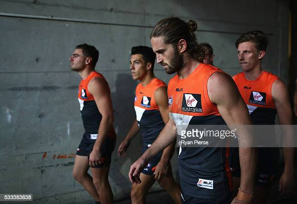 Stephen Coniglio Dylan Shiel Callan Ward and Lachie Whitfield of the Giants lead their team out during the round nine AFL match between the Greater...