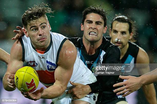 Stephen Coniglio of the Giants handballs during the round 18 AFL match between the Port Adelaide Power and the Greater Western Sydney Giants at...