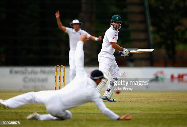 Stephen Cook of South Africa cuts it away as Alex Hales tries to stop runs during day one of the tour match between South Africa A and England at...