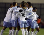 Stephen Corica of Sydney FC celebrates with team mates after scoring a goal during their AFC Champions League 2007 match between the Sydney FC of...