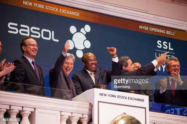 Stephen Cornell center left and Bongani Nqwababa center joint presidents and chief executive officers of Sasol Ltd ring the opening bell on the floor...