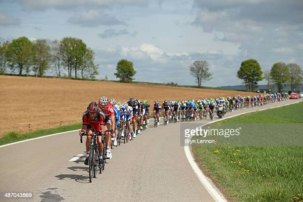 Stephen Cummings of Great Britain and BMC Racing Team leads the peloton through the Belgian countryside towards Bastogne during the 100th edition of...