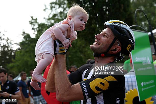 Stephen Cummings of Great Britain and MTNQhubeka holds his daughter before the start of stage eleven of the 2015 Tour de France a 188 km stage...