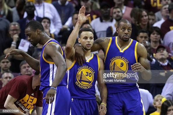 Stephen Curry and Andre Iguodala of the Golden State Warriors walk off the court during a time out against the Cleveland Cavaliers during the fourth...
