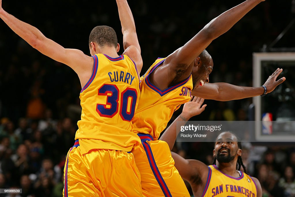 Stephen Curry and Anthony Tolliver celebrate after a made basket in a game against the Los Angeles Clippers on February 10 2010 at Oracle Arena in...