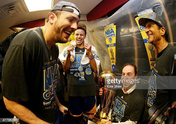 Stephen Curry and David Lee of the Golden State Warriors celebrates with team owners Peter Guber and Joe Lacob and the Larry O'Brien NBA Championship...