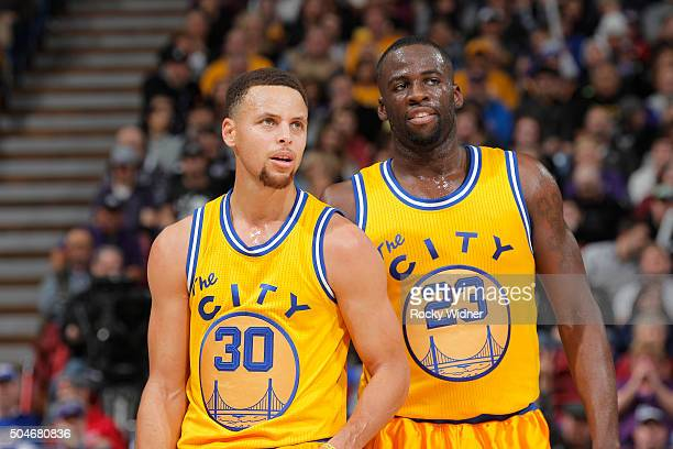 Stephen Curry and Draymond Green of the Golden State Warriors face the Sacramento Kings on January 9 2016 at Sleep Train Arena in Sacramento...