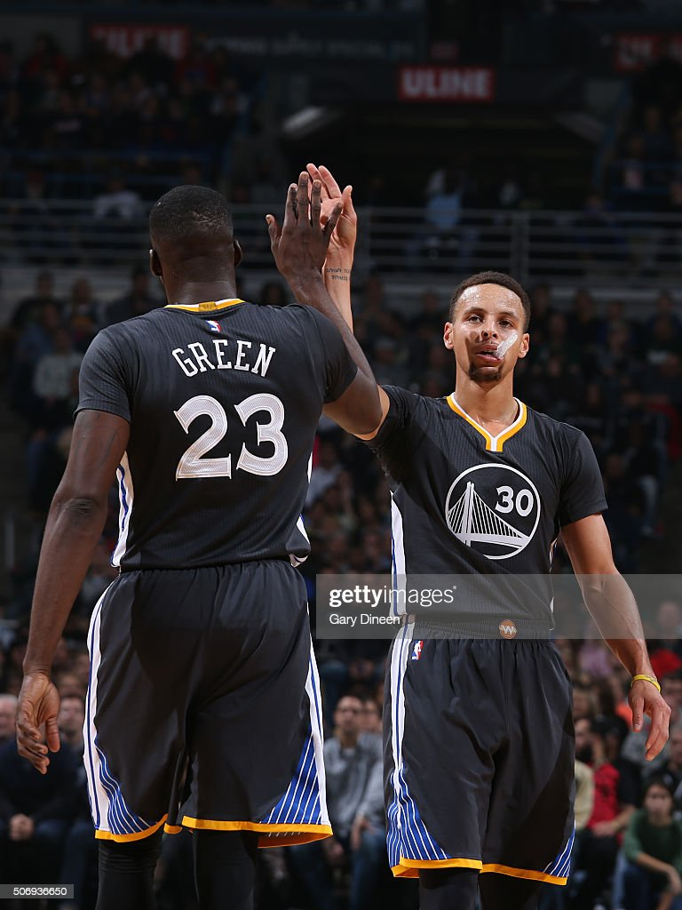<a gi-track='captionPersonalityLinkClicked' href=/galleries/search?phrase=Stephen+Curry+-+Basketball+Player&family=editorial&specificpeople=5040623 ng-click='$event.stopPropagation()'>Stephen Curry</a> #30 and <a gi-track='captionPersonalityLinkClicked' href=/galleries/search?phrase=Draymond+Green&family=editorial&specificpeople=5628054 ng-click='$event.stopPropagation()'>Draymond Green</a> #23 of the Golden State Warriors high five each other during the game against the Milwaukee Bucks on December 12, 2015 at the BMO Harris Bradley Center in Milwaukee, Wisconsin.