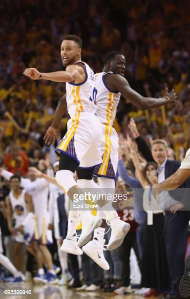 Stephen Curry and Draymond Green of the Golden State Warriors celebrate in the final moments of their 129120 win over the Cleveland Cavaliers in Game...
