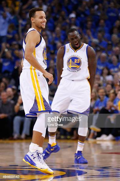 Stephen Curry and Draymond Green of the Golden State Warriors react after a three point basket by Green against the New Orleans Pelicans during the...