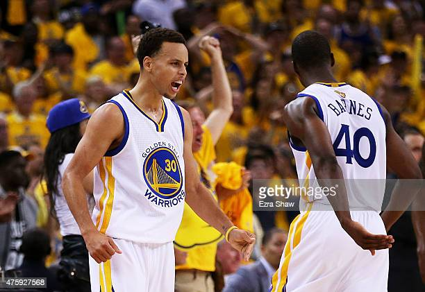 Stephen Curry and Harrison Barnes of the Golden State Warriors react in overtime against the Cleveland Cavaliers during Game One of the 2015 NBA...