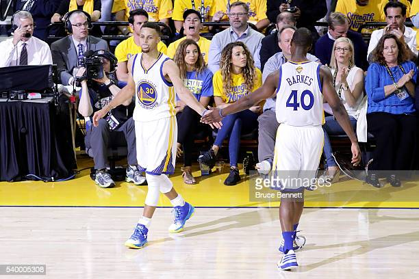 Stephen Curry and Harrison Barnes of the Golden State Warriors reacts during the first quarter against the Cleveland Cavaliers in Game 5 of the 2016...