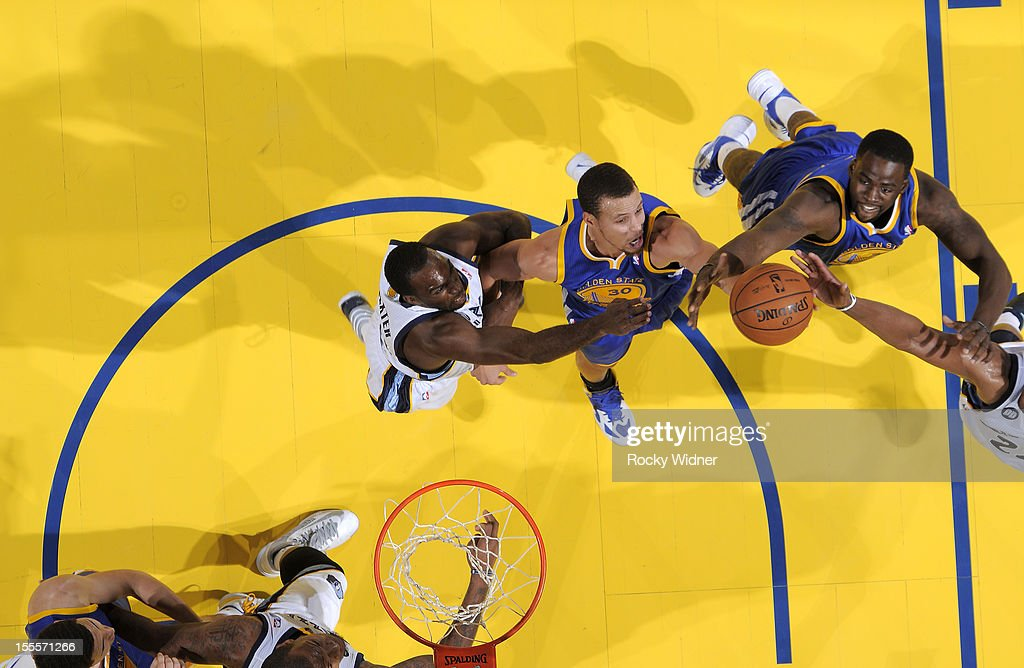 Stephen Curry #30 and <a gi-track='captionPersonalityLinkClicked' href=/galleries/search?phrase=Harrison+Barnes&family=editorial&specificpeople=6893973 ng-click='$event.stopPropagation()'>Harrison Barnes</a> #40 of the Golden State Warriors rebounds the ball against <a gi-track='captionPersonalityLinkClicked' href=/galleries/search?phrase=Rudy+Gay&family=editorial&specificpeople=236066 ng-click='$event.stopPropagation()'>Rudy Gay</a> #22 and <a gi-track='captionPersonalityLinkClicked' href=/galleries/search?phrase=Quincy+Pondexter&family=editorial&specificpeople=4176540 ng-click='$event.stopPropagation()'>Quincy Pondexter</a> #20 of the Memphis Grizzlies on November 2, 2012 at Oracle Arena in Oakland, California.