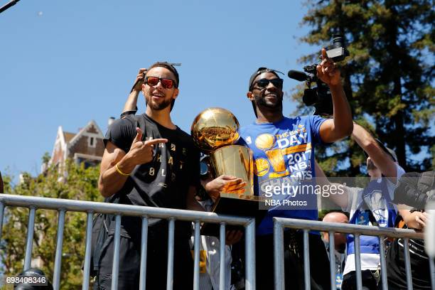 Stephen Curry and Ian Clark of the Golden State Warriors hold up the Larry O'Brien Trophy during the Victory Parade and Rally on June 15 2017 in...