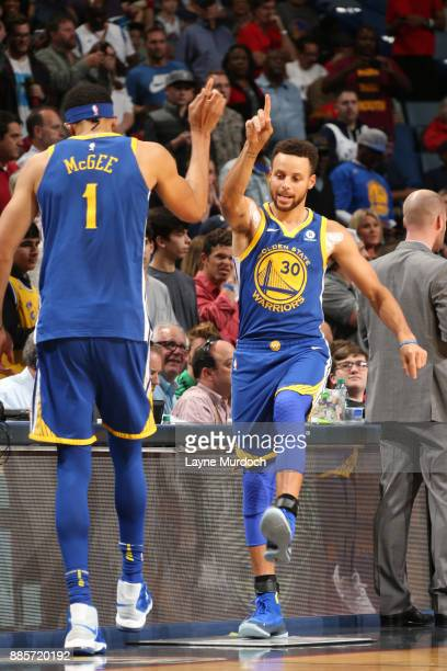 Stephen Curry and JaVale McGee of the Golden State Warriors are seen during the game against the New Orleans Pelicans on December 4 2017 at Smoothie...