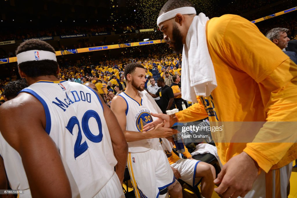 Stephen Curry #30 and JaVale McGee #1 of the Golden State Warriors high five during Game One of the Western Conference Semifinals against the Utah Jazz during the 2017 NBA Playoffs on May 2, 2017 at ORACLE Arena in Oakland, California.