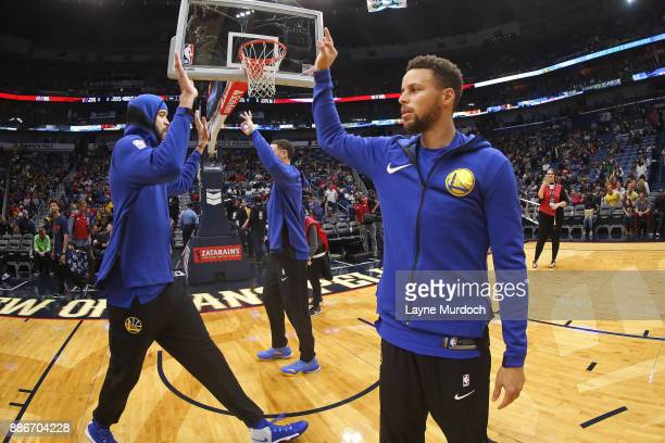 Stephen Curry and JaVale McGee of the Golden State Warriors warm up before game against the New Orleans Pelicans on December 4 2017 at Smoothie King...