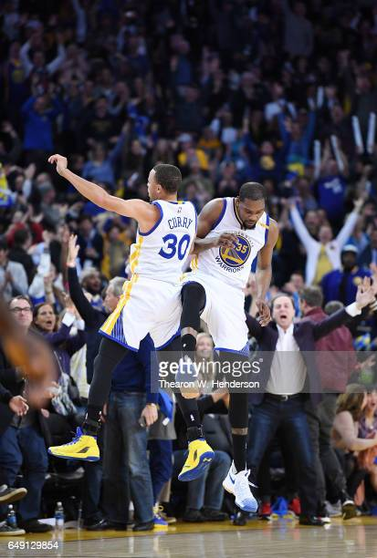 Stephen Curry and Kevin Durant of the Golden State Warriors celebrates after Curry made a threepoint shot against the LA Clippers during an NBA...