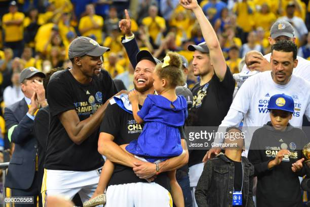 Stephen Curry and Kevin Durant of the Golden State Warriors celebrates after winning the NBA Championship against the Cleveland Cavaliers in Game...