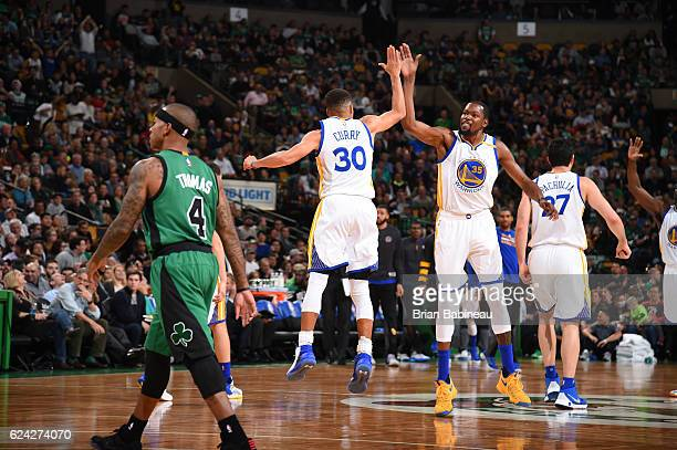 Stephen Curry and Kevin Durant of the Golden State Warriors celebrate during a game against the Boston Celtics on November 18 2016 at TD Garden in...